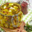 Marinated cheese in olive oil — Stock Photo #40076683