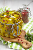 Marinated cheese in olive oil — Stock Photo