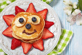 Pancakes with berries for kids — Stock Photo