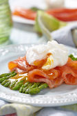 Poached egg with salmon and asparagus — Stock Photo