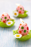 Easter decoration with flowers, candles and eggs — Stock Photo