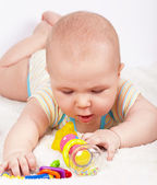 Baby boy playing with a teething toy — Stock Photo