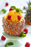 Fruit sorbet ice cream in small pineapple — Stock Photo