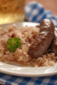 Grilled bavarian sausages with sauerkraut — Stock Photo