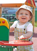 Kid playing on playground — Stock Photo