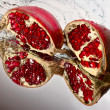 Stock Photo: Two slices of ruby pomegranate