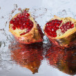 Stock Photo: Pomegranate slices and splash