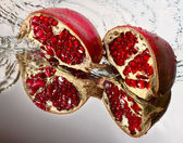 Two slices of ruby pomegranate — Stock Photo