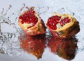 Pomegranate slices and a splash — Stock Photo