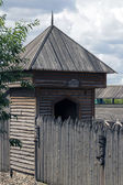Wooden tower and the wall of the stockade — Stock Photo