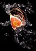 Figs in a spray of water — Stock Photo