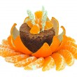 Chocolate dessert decorated with tangerines - Stock Photo