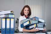 Woman carries files — Stock Photo