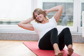 Pretty young women makes fitness — Stock Photo