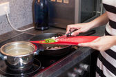 Woman cooks — Stock Photo