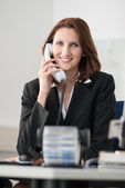 Young businesswoman phones — Stock Photo