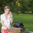 Royalty-Free Stock Photo: Woman with smart phone in the park