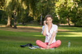 Pretty young woman phones — Stock Photo