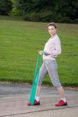 Vrouw met fitness band — Stockfoto