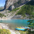 Stock Photo: Canoes at Moraine Lake