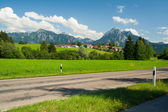 Street in front of the alps — Stock Photo