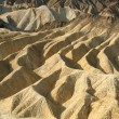 Rock formations at the Zabriskie Point - Stock Photo