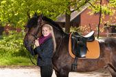 Girl with pony — Stock Photo