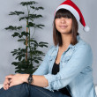 Young womwith Christmas hat — Stock Photo #37045831