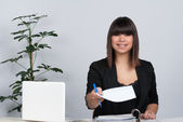 Woman hands over a sheet of paper — Stock Photo