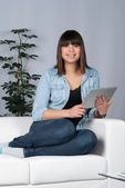 Woman holds a tablet — Stock Photo