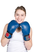 Woman holds boxing gloves under her chin — Stock Photo