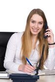 Young woman phones at the desk — Stock Photo