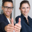 Two women are showing thumbs up — Stock Photo #47223373
