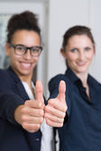 Two women are showing thumbs up — Stock Photo