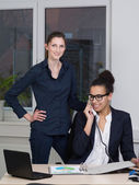 Two business women are working in the office — Stock Photo