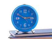 The alarm clock standing on books — Stock Photo