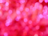 Abstract light bokeh on pink background — Stock Photo