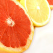 Foto Stock: Lemons and grapefruit