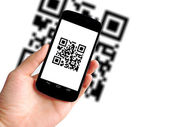 Scanning QR code with mobile phone — Stock Photo