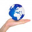 World globe in hand — Stock Photo
