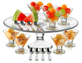 Fresh fruits on cups — Stock Photo