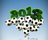 3D 2013 year grass text, title with Footballs in sky — Stock Photo
