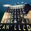 Cancelled on a mechanical timetable sky and plane - Stock Photo