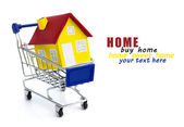 Shopping cart with house — Stock Photo