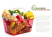 Shopping basket with groceries — Stock Photo