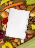 Vegetables with notebook — Stock Photo