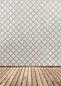 Wall with wallpaper and wood floor — Stock Photo