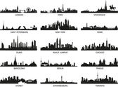 Vector silhouettes of the city skylines — Stock Vector