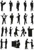 Vector businessman and businesswoman silhouettes — Stock Vector