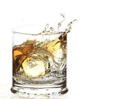A Glass of whisky with ice cube splash — Stock Photo